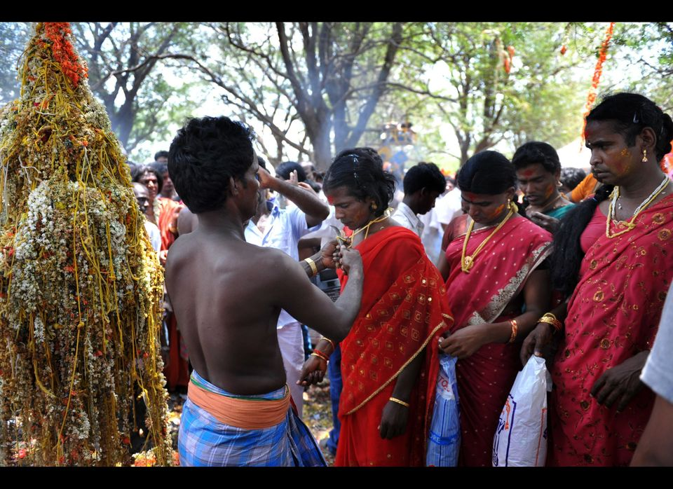 Indian transgenders have their thalis taken off by priests after a 'thali' ritual signifying their marrriage to the Hindu god
