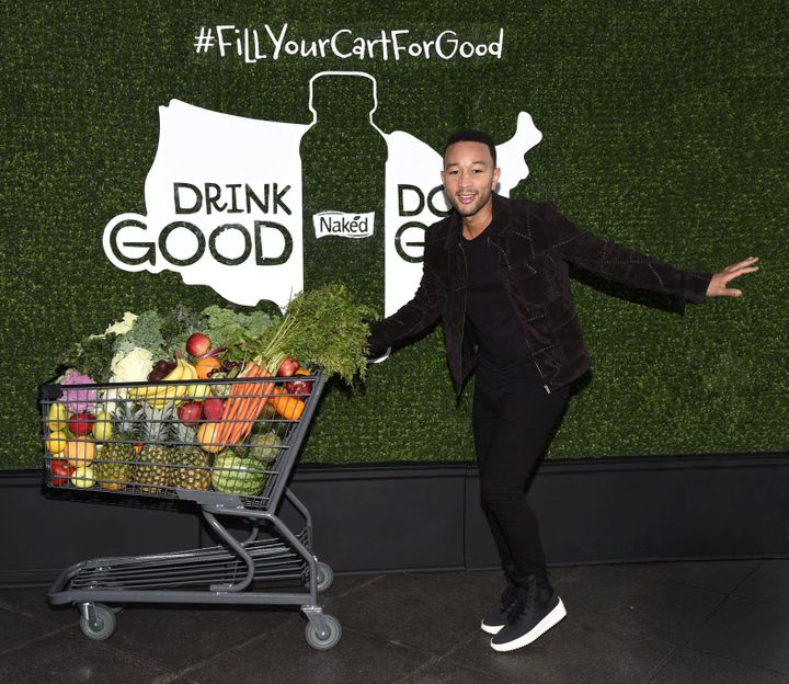 "At Naked's Drink Good Do Good campaign launch, John Legend shows off his ""shopping cart dance"" to help communities in need."
