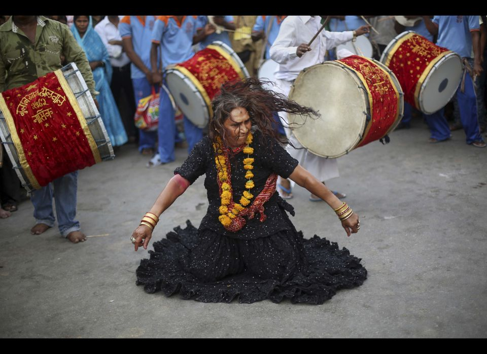 An Indian Muslim Sufi devotee dances with a band during a procession to the revered Muslim Shrine of Ajmer Sharif during the