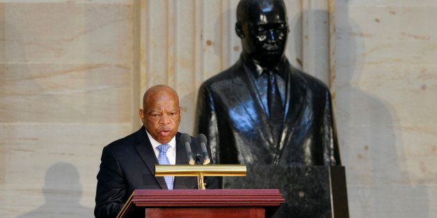 Rep. John Lewis, D-Ga., stands in front of a statue of Dr. Martin Luther King, Jr., as he speaks during a 50th anniversary ceremony for the Civil Rights Act of 1964, Tuesday, June 24, 2014, in the Capitol Rotunda on Capitol Hill in Washington. A Congressional Gold Medal in honor of Dr. and Mrs. Martin Luther King, Jr., who were instrumental in the law's passage, was also presented. (AP Photo/Susan Walsh)