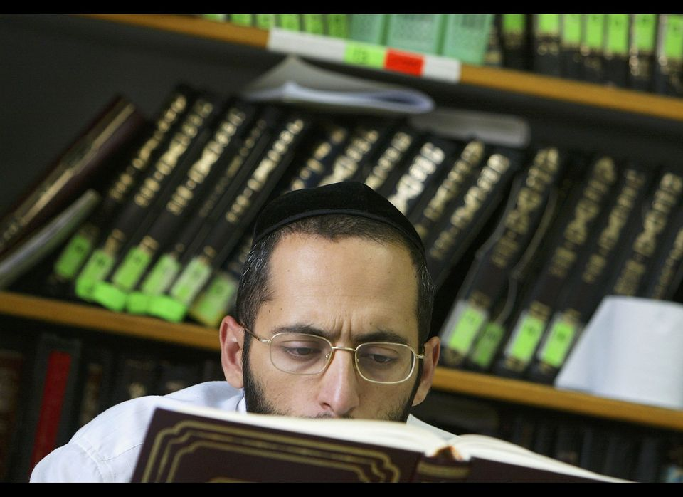 A religious Jewish scholar reads from the Talmud during his studies at leading Kabbalist Rabbi Yitzhak Kadouri's synagogue. (