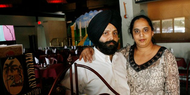 ** ADVANCE FOR RELEASE SUNDAY, MAY 18, 2008 AND THEREAFTER **Rana Singh Sodhi, left, and his wife Sukhbir Kaur stand inside t