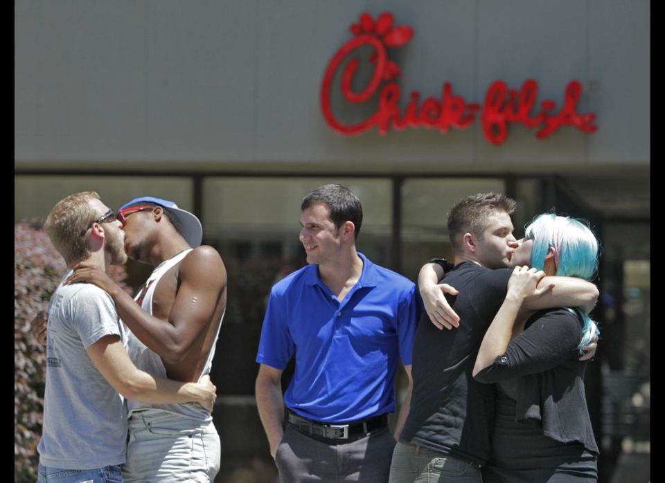 "Protesters take part in a ""Kiss In"" outside a Chick-fil-A restaurant on Friday, Aug. 3, 2012 in Atlanta. Gay rights activists"