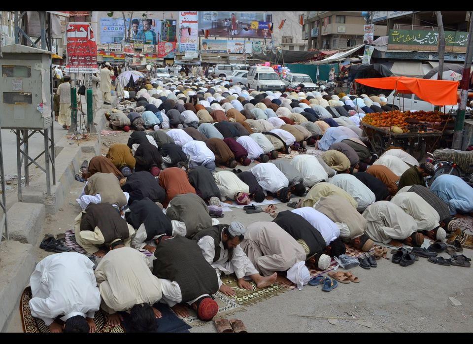 Pakistani Muslims offer Jummat-ul-Vida, last Friday, prayers on a street during the holy month of Ramadan in Quetta on August