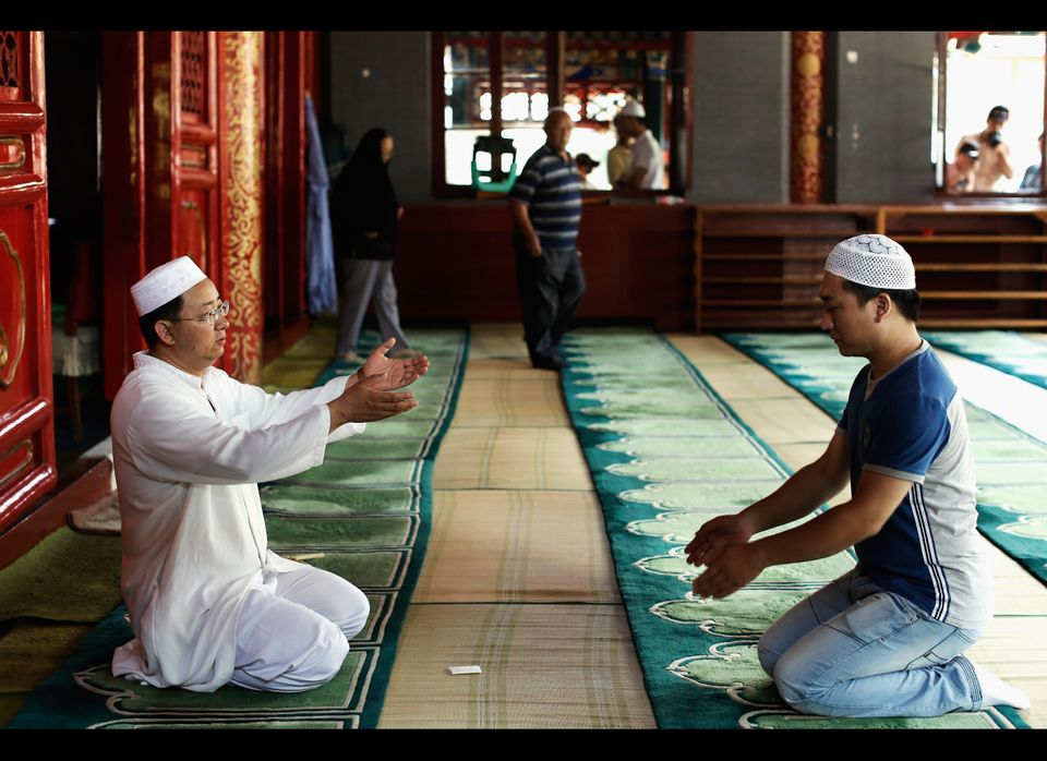 BEIJING, CHINA - AUGUST 19: Muslims pray on the first day of Eid al-Fitr at Niu Jie Mosque to celebrate Eid al-Fitr on August