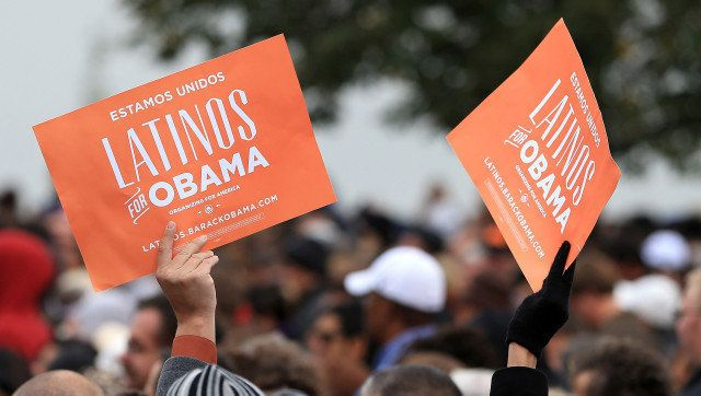 DENVER, CO - OCTOBER 04:  Latino supporters hold up signs as they attend a campaign rally for U.S. President Barack Obama at