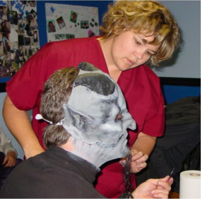 Pastor Keenan preparing mask & make-up as Demon Tour Guide