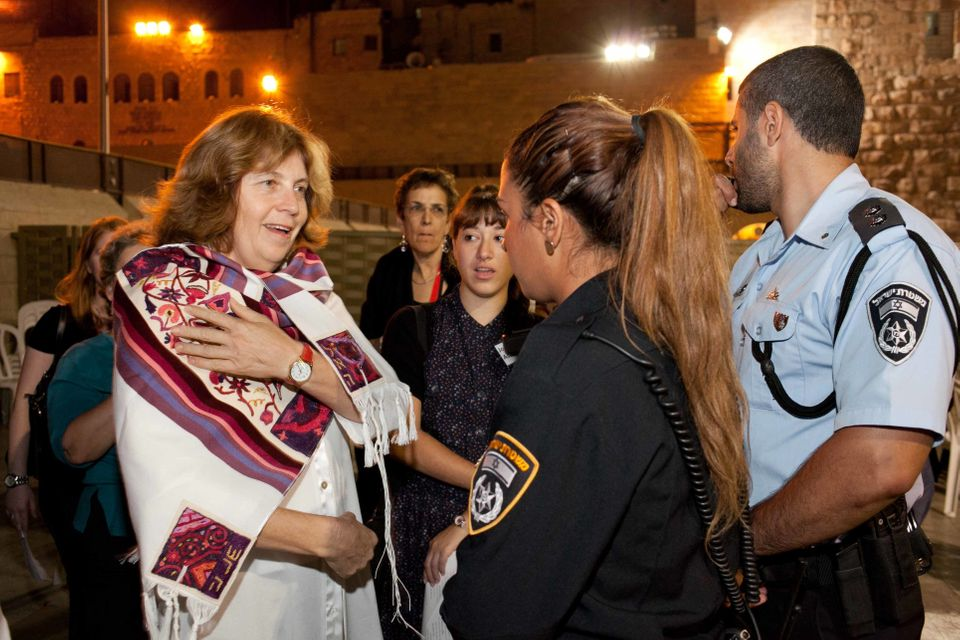 Anat Hoffman is confronted by Israeli police at the Western Wall. (Photo credit: Michal Fattal/Women of the Wall)