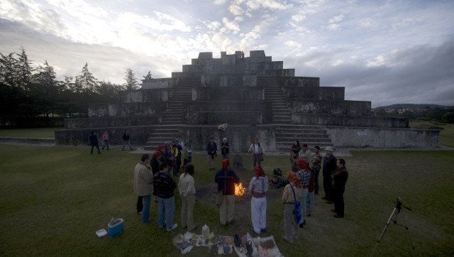 Indigenous priests take part in a Mayan ceremony at the Zaculeu archaeological site, in the Huehuetenango department, 270 km