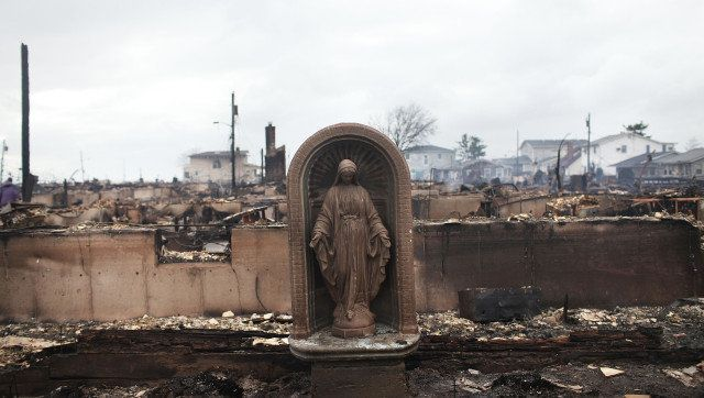 NEW YORK, NY - OCTOBER 30: A Virgin Mary is all that remains from a home which was destroyed during Hurricane Sandy in Breezy