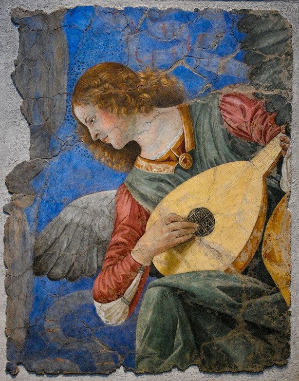 description A fragment of a circa-1480 fresco of an angel with a halo strumming a lute and glancing  ... wikipedia | File:Vat