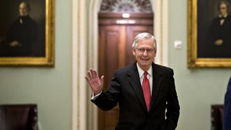 Senate Majority Leader Mitch McConnell, a Republican from Kentucky, waves while walking through the U.S. Capitol in Washington, D.C., U.S., on Friday, Oct. 5, 2018. The U.S. Senate is closing in on sending Brett Kavanaugh to the Supreme Court, which would seal a conservative majority and close a bitterly fought confirmation process that hinged on allegations of sexual misconduct. Photographer: Andrew Harrer/Bloomberg via Getty Images