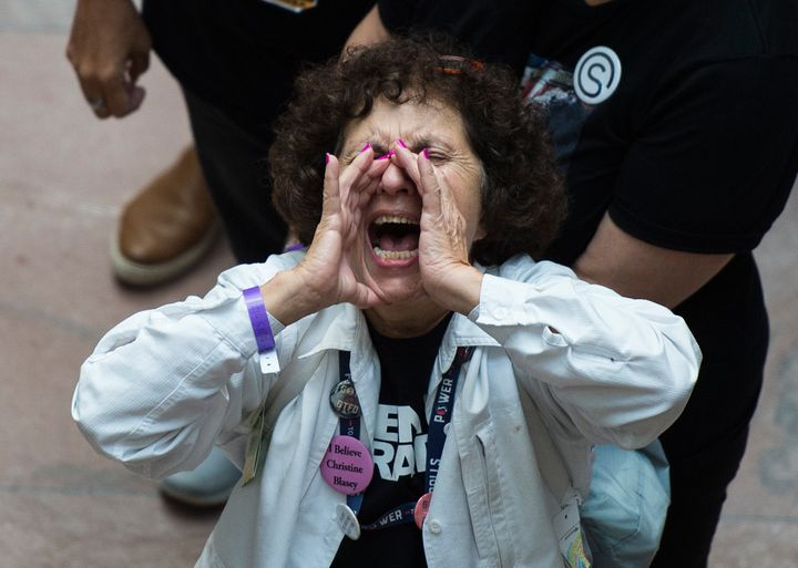 A demonstrator in the Hart Senate Office Building in Washington during a protest against Supreme Court nominee Brett Kav