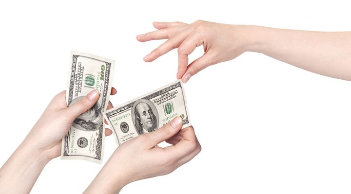 hand giving money to other hand ...