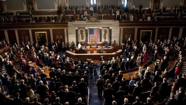 Members of the 113th US House of Representatives recite the Pledge of Allegience during the opening session at the US Capitol