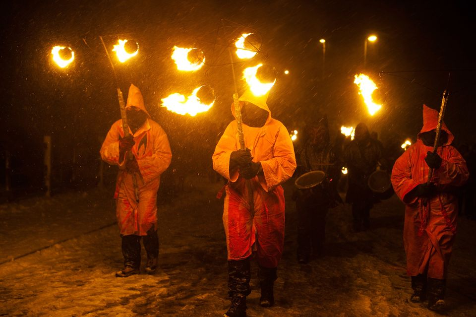 HUDDERSFIELD, ENGLAND - FEBRUARY 04: Hooded torch bearers lead the winter procession through the snow on February 4, 2012 in