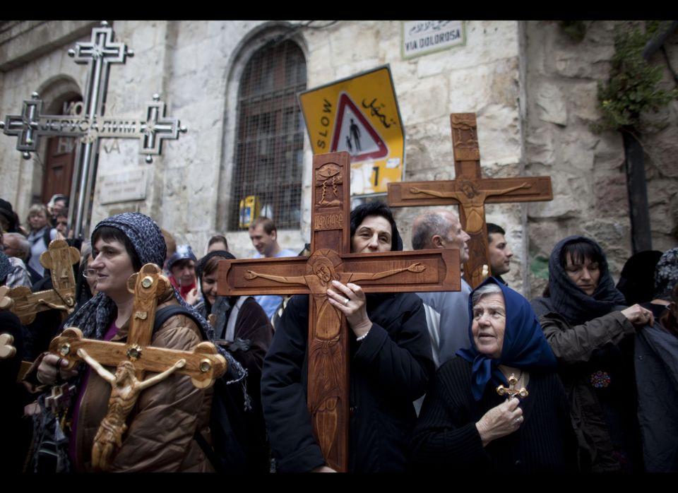 JERUSALEM, ISRAEL - APRIL 22:  (ISRAEL OUT) Chrisitan pilgrims carry wooden crosses along the Via Dolorosa during the Good Fr