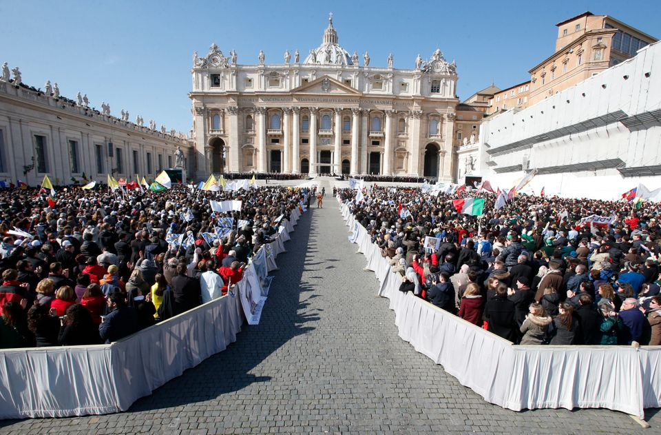 """Faithful gather in St. Peter's Square at the Vatican, Wednesday, Feb. 27, 2013. Pope Benedict XVI has recalled moments of """"jo"""