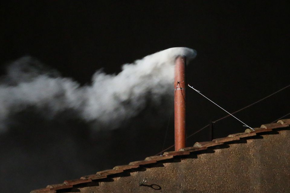 VATICAN CITY, VATICAN - MARCH 13: White smoke is seen from the roof of the Sistine Chapel indicating that the College of Card