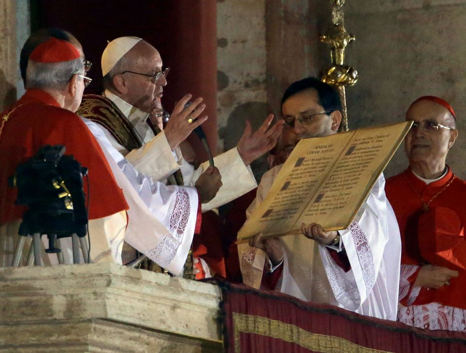 Pope Francis speaks from the central balcony of St. Peter's Basilica at the Vatican, Wednesday, March 13, 2013. Cardinal Jorg