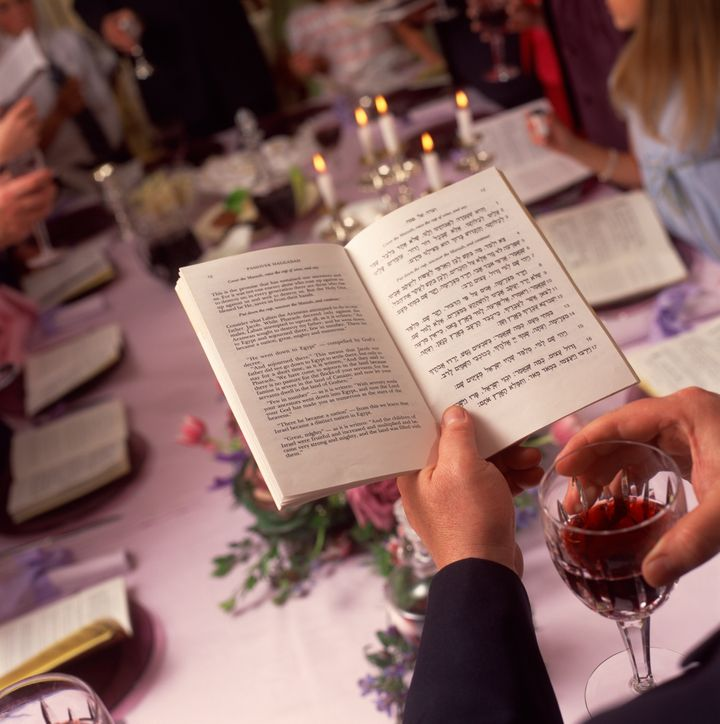 Person reading at Passover meal