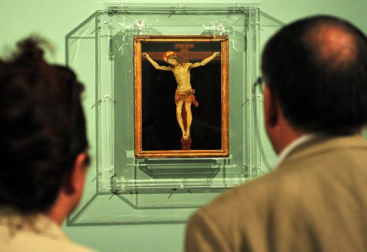 Visitors look at 'Crucifixion' by 15th century master Filippino Lippi during the 'Filippino Lippi and Sandro Boticelli nella