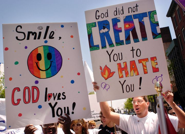 PHILADELPHIA - MAY 1:  Activists display signs as they march in support of gay rights during Equality Forum's 40th anniversar