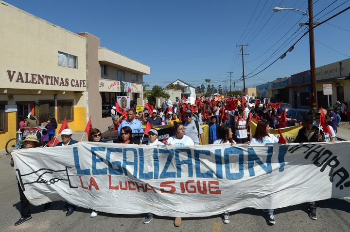 Hundreds of people march through the streets of Oxnard, California, as they participate in a march for immigration reform and