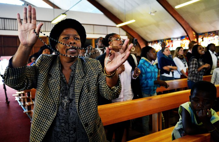A church goer sings and dances at Regina Mundi church in Soweto on March 31, 2013. Regina Mundi church is situated near forme