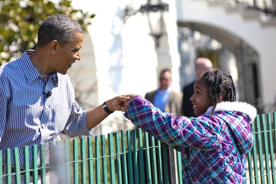 US President Barack Obama fist bumps a young admirer on the South Lawn of the White House in Washington, DC, April 1, 2013 at