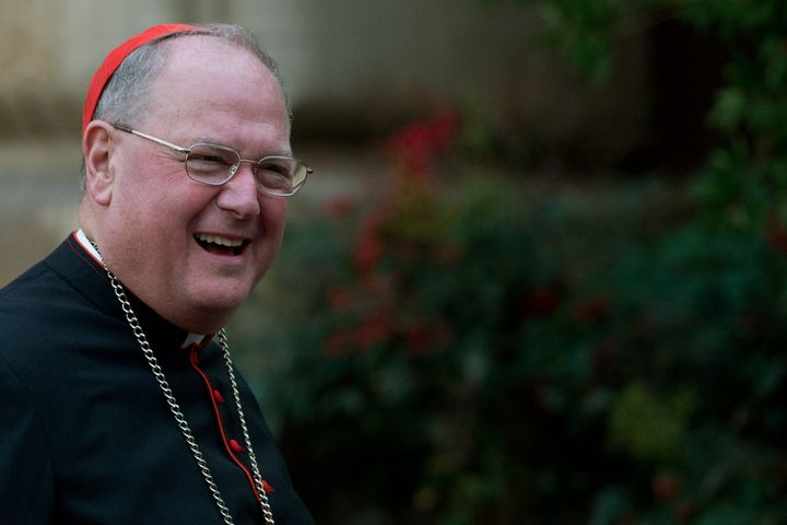 US cardinal Timothy Michael Dolan arrives for a meeting on the eve of the start of a conclave on March 11, 2013 at the Vatica