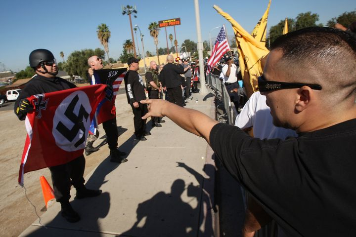 RIVERSIDE, CA - OCTOBER 24:  Members of the white supremacist group, the National Socialist Movement and counter-protesters f