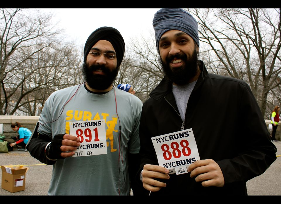 Urjit Singh and Harpreet Singh receive their running bibs before the Sunday morning race.