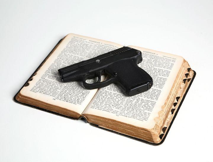 Pistol on Open Bible