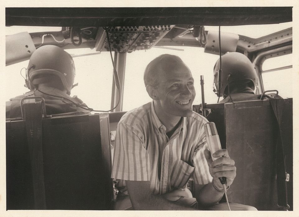 1966, on board a Huey helicopter recording a story for NBC in Vietnam