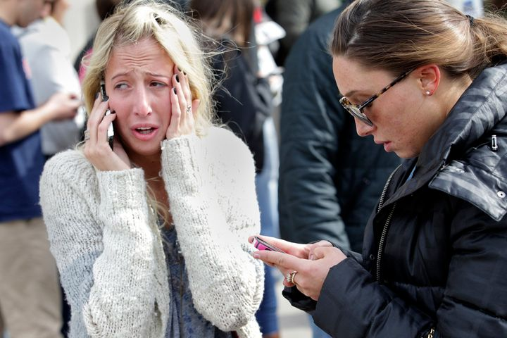 BOSTON - APRIL 15: Women desperate to hear from loved ones can't enter the scene at Boylston and Mass. Ave. after two explosi