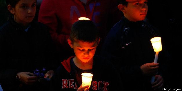 BOSTON, MA - APRIL 16: Young children stand with lit candles during a vigil for eight-year-old Martin Richard, from Dorcheste