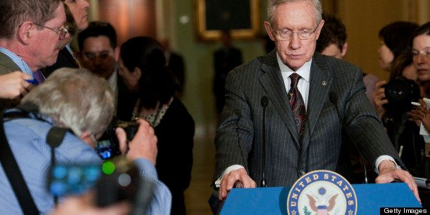 UNITED STATES - APRIL 9: Senate Majority Leader Harry Reid, D-Nev., speaks to the press after the Senate policy luncheons in