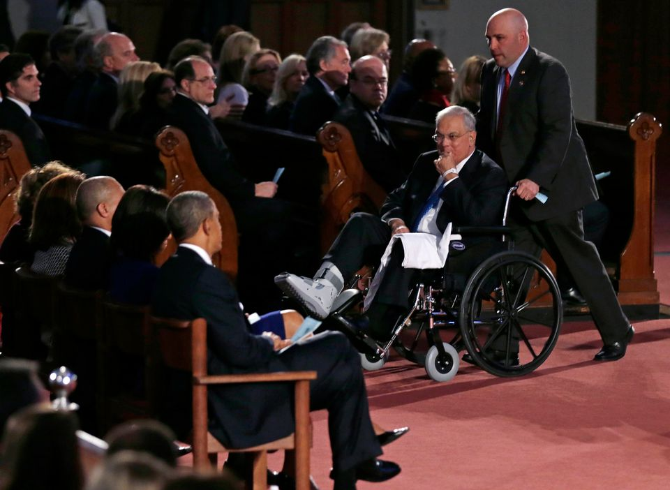 Boston Mayor Tom Menino passes President Barack Obama and first lady Michelle Obama during an interfaith healing service at t