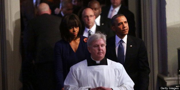 BOSTON, MA - APRIL 18:  President Barack Obama (R) and first lady Michelle Obama enter an interfaith prayer service for victi
