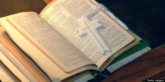 Open bible with cross bookmark