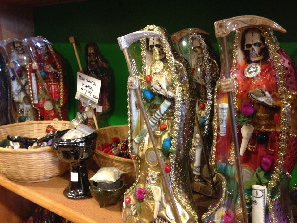 FILE - In this Feb. 13, 2013 file photo, statues of La Santa Muerte are shown at the Masks y Mas art store in Albuquerque, N.