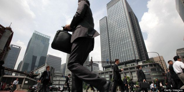 Morning commuters make their way to work in Tokyo, Japan, on Tuesday, May 29, 2012. Japan's jobless rate unexpectedly rose an