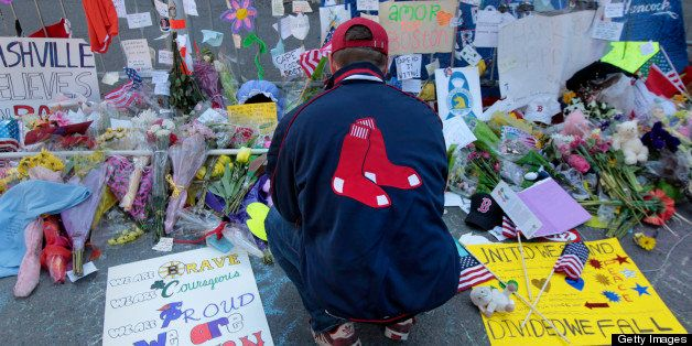 BOSTON - APRIL 22: Kevin Krueger of the North End pays his respect to the memorial on the Massachusetts Avenue end of Boylsto