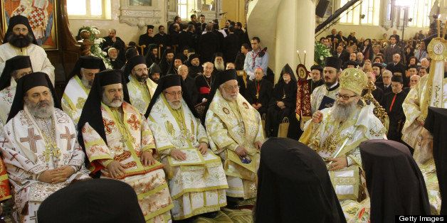 (FILES) -- A file picture taken on February 10, 2013 shows Syrian Bishop Boulos Yaziji (seated-L), head of the Greek Orthodox