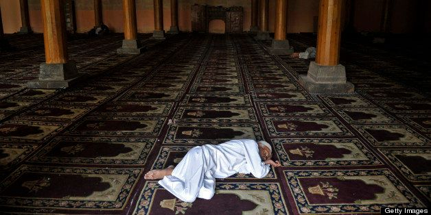 A Kashmiri Muslim takes a nap at the landmark Jamia Masjid in Srinagar on August 2, 2011. For Muslims across the world, the b