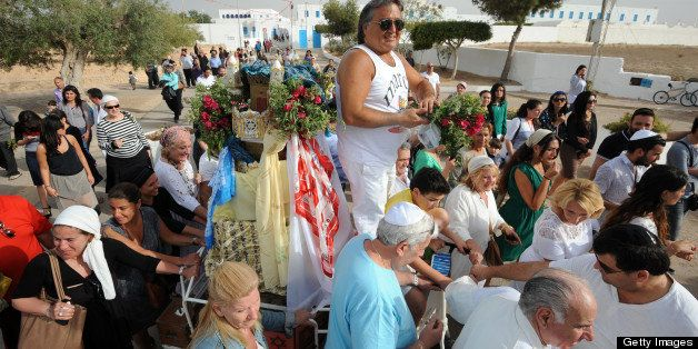 Jewish pilgrims, including members of Tunisia's diminished Jewish community, take part in the procession of the Menara outsid