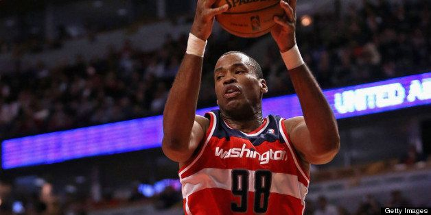 CHICAGO, IL - APRIL 17: Jason Collins #98 of the Washington Wizards rebounds against the Chicago Bulls at the United Center o