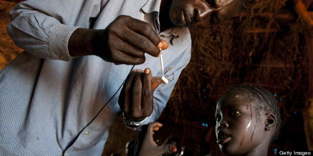 YIDA REFUGEE CAMP, SOUTH SUDAN - JULY 5:  A girl with a high fever gets tested for malaria at the CARE medical clinic at the