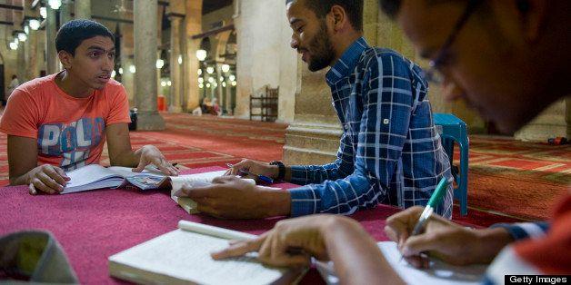 CAIRO, EGYPT - NOVEMBER 10: From left, students Yosef Ali, Mostafa Mohammed, and Saleh Ahmed study together in Al-Azhar Mosqu